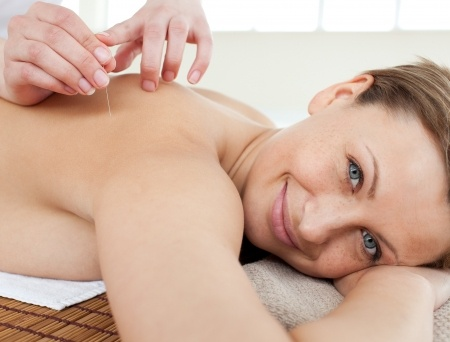 woman enjoying acupuncture