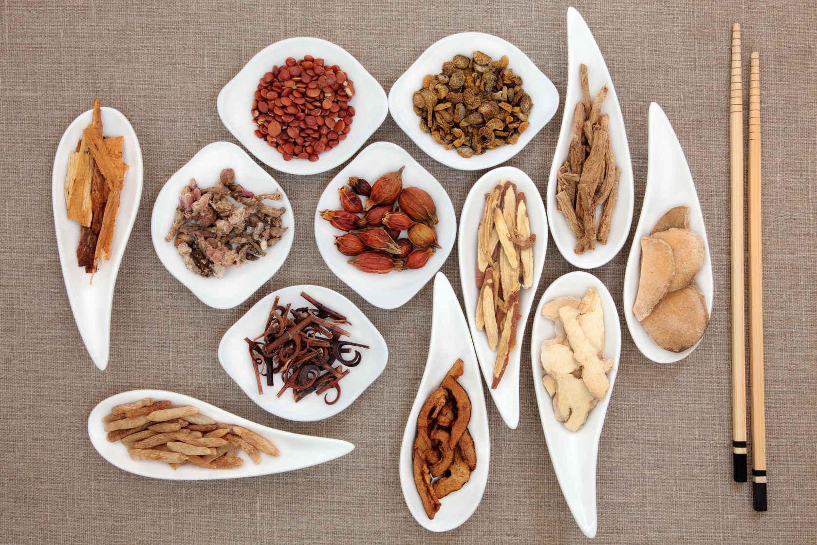Chinese herbal treatment -  Chinese Herbal Medicine Herbs In Bowls With Chopsticks